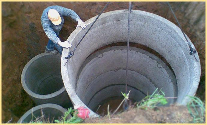 Погрузка колец в яму